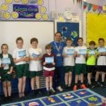 Mr Delf presents the children with their prizes and certificates.